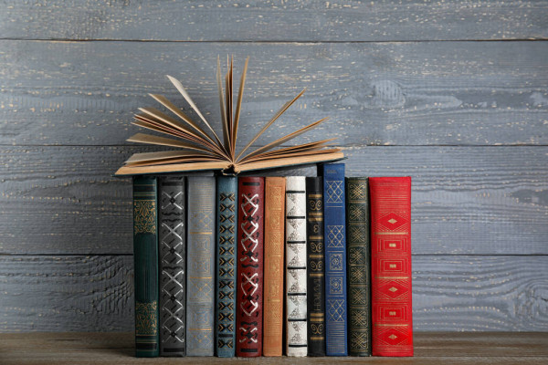 depositphotos_312713800-stock-photo-stack-of-hardcover-books-on